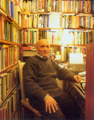 Mohamed Ben-Madani sits behind his desk at The Maghreb Bookshop. Photograph by Roger Hardy